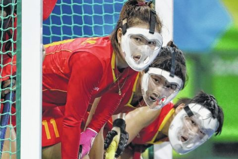 girls wearing field hockey masks