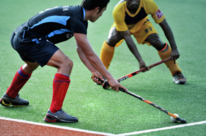 players playing field hockey